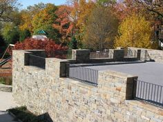 unusual retaining wall ideas with big pebbles and stone pathway colorful stones metal handrails for appealing