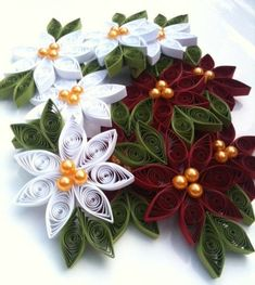 DIY paper poinsettias I love quilling.something to learn in Jan and make for e… DIY paper poinsettias I love quilling. Quilling Tutorial, Paper Quilling Designs, Quilling Paper Craft, Quilling Craft, Quilling Patterns, Quilling Christmas, Christmas Ornament Sets, Christmas Crafts, Christmas Flowers