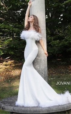 Jovani 63891 straight neckline with feather trim on the neckline and feather trim on the edge of the skirt with a sweeping train fitted mermaid evening gown wedding dress prom gown Available colors: Black, Navy, White Available sizes: Informal Wedding Dresses, Country Wedding Dresses, Black Wedding Dresses, Black Weddings, Wedding Black, Dinner Gowns, Evening Dresses, Wedding Dress With Feathers, Feather Prom Dress
