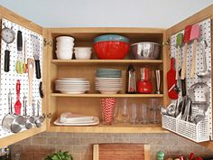 Maximize the Cabinets : The kitchen has only two small drawers, so Kelsey mounted pegboard from the hardware store to her cabinet doors for hanging measuring cups, her mandoline and other small tools.