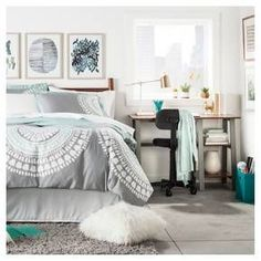 Stress-free style is what you'll get with this Small Space Blue & Gray College Bedroom. From bedding and storage to lamps and desks to wall art and rugs, you have everything you need to make your home away from home comfortable while still being chic and trendy. Just because you live in a small space doesn't mean your style has to suffer. Decorate your desk with an artificial succulent to add a touch of greenery while keeping maintenance at a minimum, and let fashion meet function...