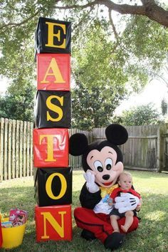 Mickey Mouse Clubhouse Party! | CatchMyParty.com (this would be so easy to do, just find same size boxes, wrap with wrapping paper, & put letters on spelling out the name! would be nice for photos like this or for entrance decoration!)