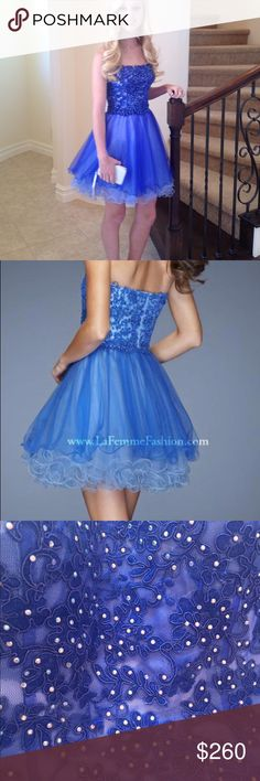 Short La Femme Prom Dress This is a gorgeous La Femme dress, perfect for homecoming or prom! It is made out of a polyester material making it very high quality and comfortable. This dress has darker blue details over a lighter blue fabric on the top, and both dark and light blue tulle on the bottom. It has small sequins throughout the top of the dress and the skirt has the perfect amount of volume. This dress fits true to size (2), and I have only worn it once (to prom) but this dress looks…