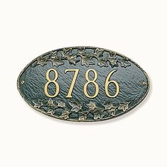 Ivy Oval Wall-Mount Address Plaque - WHITE/GOLD LETTERS - Improvements by Improvements. $74.99. Choose from a variety of color options to coordinate with your decor. Raised numbers make finding your address that much easier. Personalized address plaque features ivy detailing above and below address. Ivy Oval Wall-Mount Address Plaque is made of rust-free aluminum for long life. Personalized address plaque features ivy detailing above and below address. Raised numb... Gold Letters, White Letters, Black Letter, Green And Gold, Blue And Silver, White Gold, Dark Blue, Garden Plaques, Space Saving Storage