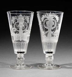 A fine pair of engraved coin goblets by Thomas Hudson Circa 1840.