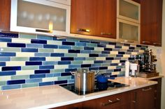 Exquisite Colorful Stone And Glass Tile Mosaic Backsplash With Brown Finish Cherry Wood Kitchen Island Using Eased Edge White Solid Slab Marble Top With Modern Kitchen Tiles  Plus Glass Tile Backsplash of Exquisite Contemporary Backsplash Ideas For Your Interesting Kitchen Decor from Interior Ideas