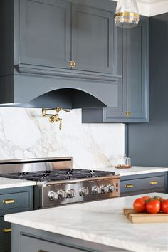 Brass Hardware. Kichen with brass hardware. Navy Grey Kitchen cabinets with brass cabinet hardware. The brass cabinet hardware is from the Martha Stewart line from Home Depot. #brasshardware #kitchenbrasshardware #kitchen #brass #hardware Willow Homes