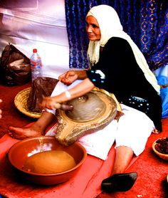 Morocco - Amlou's woman making oil from the argan fruit.