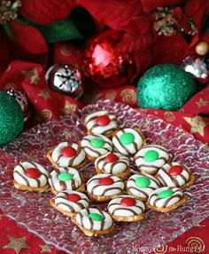 Christmas pretzel candies.  Easy!  Pretzel snaps/waffles, hersheys hugs, and M.