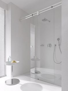 Any custom glass shower system can be created with Bartels USA.  Barn door hardware shower systems are a nice modern or contemporary look for glass shower systems.