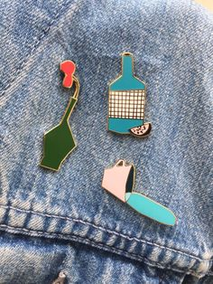 A enamel pin of a spilled drink by weareoutofoffice on Etsy