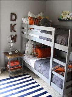 Bedroom idea for the boys. I like the grey and orange together. And the little tool box on the night stand. Very cute!