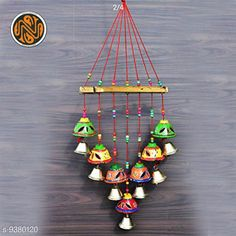 Checkout this latest Wall Decor & Hangings Product Name: * Diwali Special Beautiful Handmade Traditional Art Hanging Jhumar Showpiece Wind Chimes/Wall/Main Door/Window,/Home & Office Hanging Decorative Wind Chime with perrot(Multi-Color)* Country of Origin: India Easy Returns Available In Case Of Any Issue   Catalog Rating: ★4.1 (2971)  Catalog Name: Fancy Festive Toran CatalogID_1643875 C128-SC1318 Code: 971-9380120-243