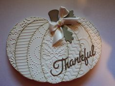 "handmade Thanksgiving card from Card Corner by Candee ... white pumpkin shaped card ... ovals cut out and embossed with different embossing folder textures ... sponged edges ... die cut ""Thankful"" in script .... great card ..."