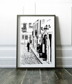 Black and white wall art. A sketch of a quiet Lisbon street. This print will look great in either a modern or more traditional setting.  Most of my prints are now available for you to print at home in my other shop here: www.etsy.com/uk/shop/NordicDesignHouseCo  MY PRINTS  This is a digital print, it is not the original sketch. Prints are produced on a professional Canon printer using Canon dye based inks and a 6 colour system to ensure vivid and rich coloured prints every tim...
