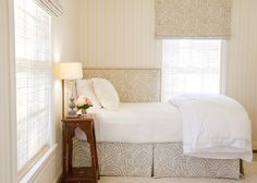 wrap around upholstered headboard.  Love the fabric, too (B & F?)