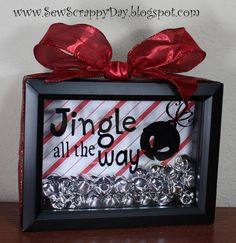 Jingle all the Way Shadow Box -- easy and inexpensive hand made Christmas present.  Great for teacher gifts!  I made mine with the Cricut, but you could also use scrapbook lettering stickers.