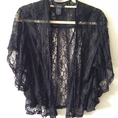 ⚡️Black lace kimono Beautiful black lace kimono is NWOT. Size XS, hangs loose, can fit up to a smaller M. Measures 20in. long, closed chest measures 16in. across laying flat. Extra long sleeve openings with butterfly style short sleeves. Sweaters