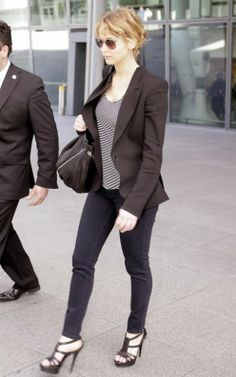 Jennifer Lawrence at the airport in skinny jeans and high heels
