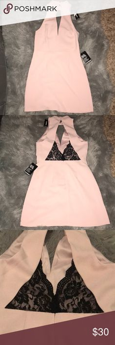 SEXY Express Cocktail Dress What a wonderful Valentine's Day surprise for your loved one 😘  Light pink mini dress of express, NWT. Deep V in front and black lacey insert in back. Fully lined. No damages, rips, or tears. Offers welcomed! Express Dresses Mini