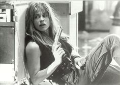 Linda Hamilton in T2: Judgment Day, 1991.  That scene in the mental hospital, where she's doing pull ups and her arms are bulging with muscle?  Yeah.  Awesome.