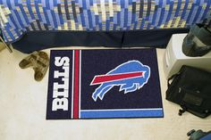 "Buffalo Bills Uniform Inspired Starter Rug 20x30 - Decorate your home or office with area rugs by FANMATS. Made in U.S.A. 100% nylon carpet and non-skid recycled vinyl backing. Officially licensed and chromojet printed in true team colors.FANMATS Series: STARTERTeam Series: NFL - Buffalo BillsProduct Dimensions: 19""x30""Shipping Dimensions: 30""x19""x0.25"". Gifts > Licensed Gifts > Nfl > Buffalo Bills. Weight: 1.80"