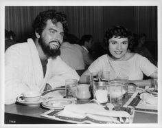 Howard Keel has lunch with a woman in publicity portrait for the film 'Jupiter's Darling', Howard Keel, Lunch, Portrait, Stars, Film, American, Woman, Movie, Headshot Photography