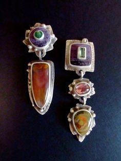 "Jim Dunakin. Earrings #5953 - Sterling Silver, Emerald on Sugilite, Mexican Flame Agate. Tourmaline on Sugilite, Tourmaline, Frog Jasper. 1/2"" x 2 1/2""."