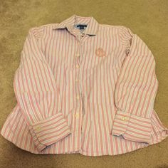 Striped Tommy Hilfiger top. Excellent used condition. Only worn a few times. No visible signs of wear. Colors are white pink and blue stripes. Tommy Hilfiger Tops