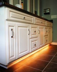 DIY Night Light! Attach a light strip at the bottom of your bathroom cabinet. No more bright light for those trips in the middle of the night!