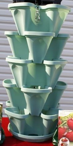 Stacking Four Clover Planter - Hanging Spring Green Colored Pots - 5 Stackable Layers by Mr. Stacky. $44.96. Great For Growing Strawberries Using a Small Amount of Space. Stackable Hanging Indoor/Outdoor Space Saving Planter - Ideal Gift Idea! - No Overwatering. Made of Heavy Duty Polypropylene and UV Inhibitors - Will Not Fade & Crack in the Sun. Includes 5 Stackers,20 Planting Locations, 1 Drip Tray, 1 Hanging Chain, 1 Locking Washer, 1 Colored Picture Instructi...
