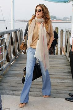 Crawford chic: Cindy Crawford arrived at the Marco Polo airport to catch her flight home on Monday following her attendance at George Clooney and Amal Alamuddin wedding