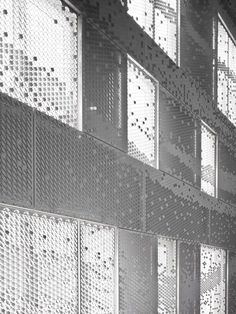 House in Amsterdam with facade of perforated hexagons, by Chris Kabel.