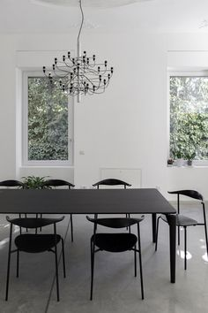 CM House is a minimalist residence located in Busto Arsizio, Italy designed by Oasi Architects Dining Etiquette, Black And White Interior, Courtyard House, Minimalist Interior, Decoration, Room Inspiration, Architecture Design, Interior Design, Design Interiors