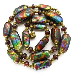 Description Some of the most beautiful beads I have ever handled. The bohemian glass beads feature stunning rainbow foiling in incredible vibrant...