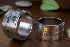 Ring Clock: A Ring That Gives You Time On Your Hands. Ring Clock is a beautiful marriage of the ring and the watch. You will be rewarded with the time, when you play with this gadget. Cool Watches, Watches For Men, Unusual Watches, Modern Watches, Wrist Watches, Ring Clock, Richard Mille, Ring Watch, Watch Case