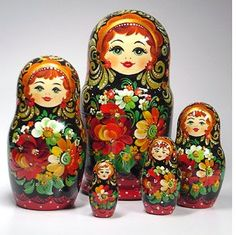 I only have two sets (inexpensive ones, at that) of Russian nesting dolls...but they fascinate me! The colors and detail are a-ma-zing! I have a decorating idea I'm tossing around in my head using these.