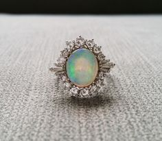 Pictures do this ring NO JUSTICE! Appraised at $4,520.00 before Tax!!  This Stunning Opal and Diamond Ring features a Vintage 1950s Ballerina