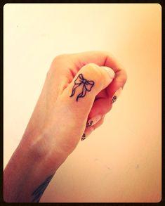 Bow tattoo.