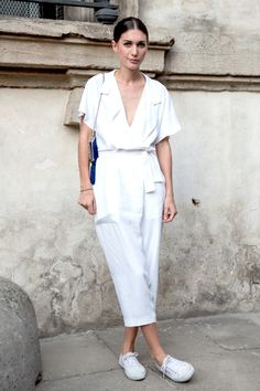 Le Fashion Blog | Photos via: Lee Oliveira | Grazia Russia  Behold! Another inspiring look from street style star Diletta Bonaiuti. This time, she's ready for the hot weather in a cute, white jumpsuit that she keeps simple with a low bun and white sneakers.  Get the look: + Illesteva Round Sunglasses + Boohoo Julia Kimono Jumpsuit + T By Alexander Wang Jumpsuit + Bebe Brook Deep V Jumpsuit + Superga Cotu Sneaker