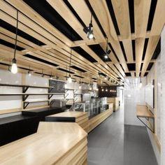 Au Pain Doré bakery by Naturehumaine  features slatted wood ceiling