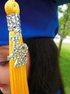 They told her she could rhinestone her cap so she rhinestoned her tassle.