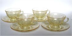 For sale is a SET of FOUR lovely elegant etched depression glass cups and saucers in the Trojan pattern. Trojan is a great Art Deco etching