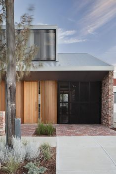 The street view of Price Street House, by architects Yun Nie Chong and Patrick Kosky in Fremantle, WA has line of site through to the kitchen and backyard, creating a warm and friendly atmosphere in this tight knit community. Photo Bo Wong