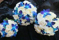 Round Wedding Bouquet Showcasing: White Roses & Blue-Violet Dendrobium Orchids