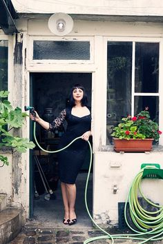 Gardening.   Dress: ASOS,   Shoes: Jimmy Choo,  Photographer: Carla Coulson, Model: Miss Pirisi, Location: Paris atelier 6eme