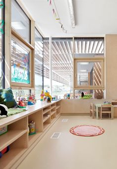Completed in 2010 in Neufeld an der Leitha, Austria. Images by Kurt Kuball. The design by SOLID architecture for the new kindergarten in Neufeld an der Leitha emerged as the winning project in a competition that sought. Classroom Architecture, Education Architecture, Interior Architecture, Kindergarten Interior, Kindergarten Design, Dream School, Nursery School, Learning Spaces, Classroom Design