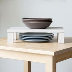 Make a Raised Plate Shelf & Maximize Cabinet Space...what an awesome use for scrap wood!
