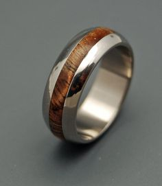 Hawaiian at heart. A domed, sloping edge adds a tender touch to this titanium band, showcasing the glowing Koa wood inlay, rich and reflective. A valuable Hawaiian hardwood historically used for carvi