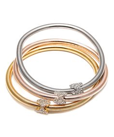 Kents Jewelry Company Tri-Tone Flower Popcorn Stretch Bracelet with Swarovski® Crystal | zulily  . $12.99 Compare at $89.00  . Product Description:  Stacked or worn separately, these lustrous mixed-metal bracelets radiate a ton of shine to highlight your wrist with glam.      Includes three bracelets  .     18k gold-plated brass / rhodium-plated brass / Swarovski® crystal  .     Imported